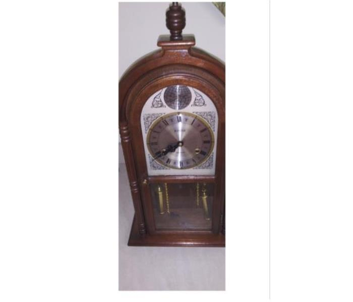 Clock after restoration from smoke damage